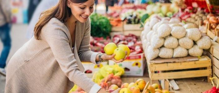 Woman picking apples at farmer's market